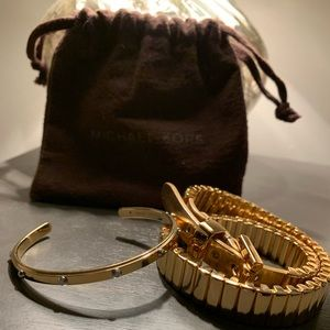 Michael Kors gold bracelets with storage bag